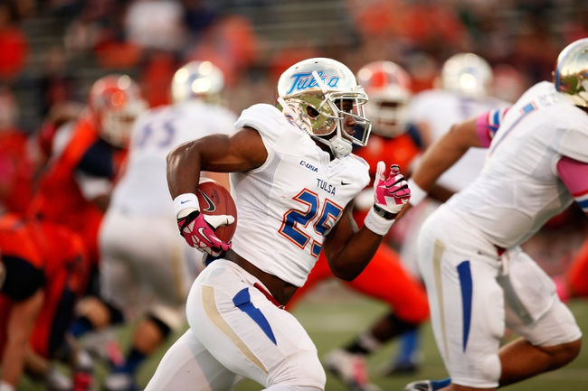 Oct 12, 2013; El Paso, TX, USA; Tulsa Hurricane running back Ja'Terian Douglas (25) leaps over a teammate as he runs the ball against the UTEP Miners defense during the first half at Sun Bowl Stadium. Mandatory Credit: Ivan Pierre Aguirre-USA TODAY Sports