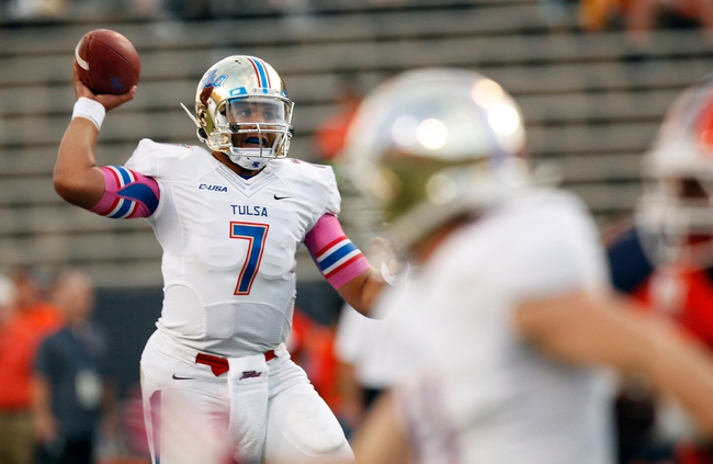 Oct 12, 2013; El Paso, TX, USA; Tulsa Hurricane quarterback Cody Green (7) drops back to pass the ball against the UTEP Miners defense at Sun Bowl Stadium. Mandatory Credit: Ivan Pierre Aguirre-USA TODAY Sports
