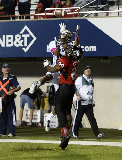 Oct 12, 2013; DeKalb, IL, USA; Northern Illinois Huskies cornerback Paris Logan (29) breaks up a pass for Akron Zips wide receiver Jerrod Dillard (88) during the second half at Huskie Stadium. Northern Illinois defeats Akron 27-20. Mandatory Credit: Mike DiNovo-USA TODAY Sports