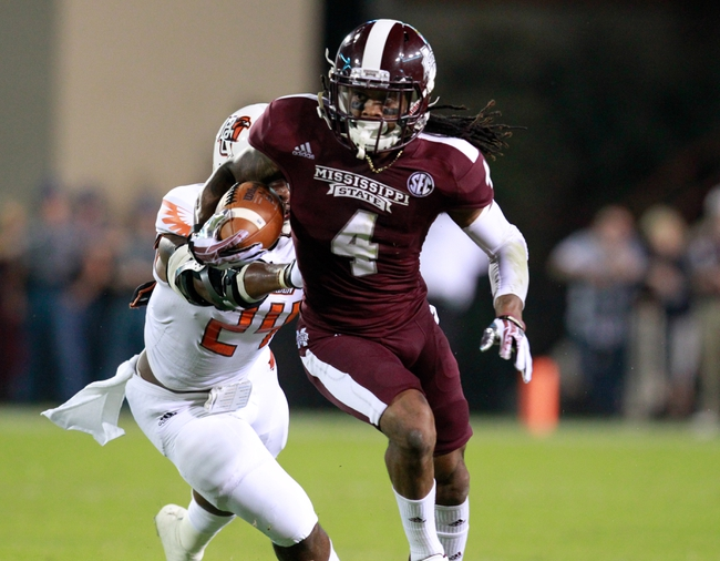 Oct 12, 2013; Starkville, MS, USA; Mississippi State Bulldogs wide receiver Jameon Lewis (4) carries the ball and is pursued by Bowling Green Falcons defensive back Jerry Gates (24) at Davis Wade Stadium. Mandatory Credit: Marvin Gentry-USA TODAY Sports