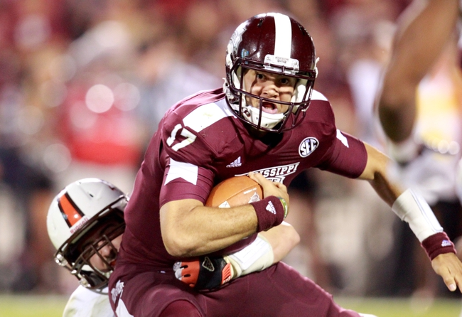 Oct 12, 2013; Starkville, MS, USA; Mississippi State Bulldogs quarterback Tyler Russell (17) is brought down by a Bowling Green Falcons defender at Davis Wade Stadium. Mandatory Credit: Marvin Gentry-USA TODAY Sports