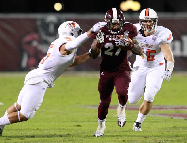 Oct 12, 2013; Starkville, MS, USA; Mississippi State Bulldogs LaDarious Perkins carries the ball as Bowling Green Falcons defensive back James Sanford (35) reaches out for him at Davis Wade Stadium. Mandatory Credit: Marvin Gentry-USA TODAY Sports