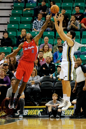 Oct 12, 2013; Salt Lake City, UT, USA; Los Angeles Clippers center DeAndre Jordan (6) blockes Utah Jazz center Enes Kanter (0) shot during the first quarter at EnergySolutions Arena. Mandatory Credit: Chris Nicoll-USA TODAY Sports