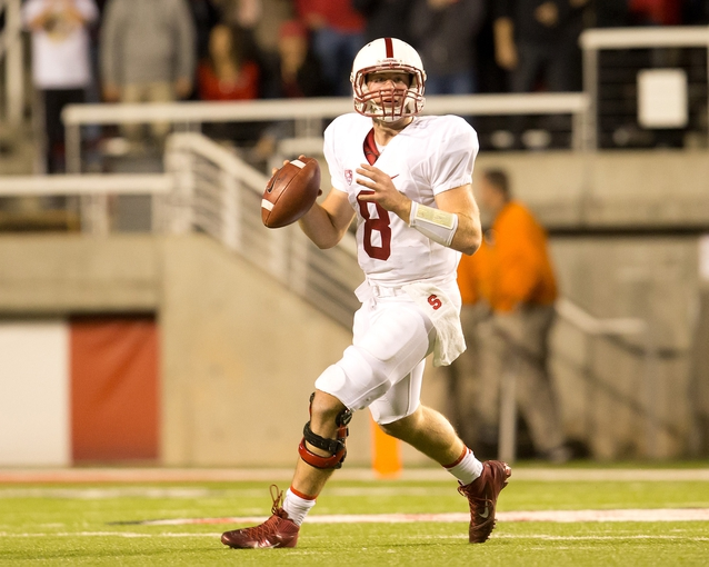 Oct 12, 2013; Salt Lake City, UT, USA; Stanford Cardinal quarterback Kevin Hogan (8) rolls out and looks to pass during the second half against the Utah Utes at Rice-Eccles Stadium. Utah defeated Stanford 27-21. Mandatory Credit: Russ Isabella-USA TODAY Sports