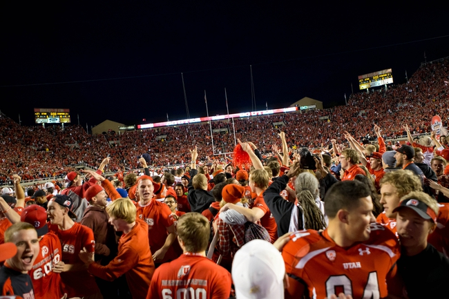 Oct 12, 2013; Salt Lake City, UT, USA; Utah Utes fans rush the field to celebrate Utah's victory over the Stanford Cardinal at Rice-Eccles Stadium. Utah defeated Stanford 27-21. Mandatory Credit: Russ Isabella-USA TODAY Sports