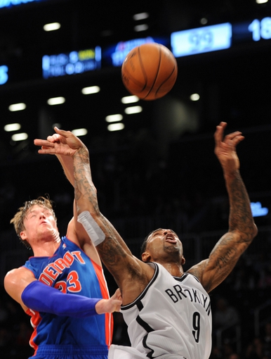 Oct 12, 2013; Brooklyn, NY, USA; Detroit Pistons power forward Jonas Jerebko (33) blocks a shot by Brooklyn Nets forward Gary Forbes (9) during the second half of the preseason game at Barclays Center. The Pistons won the game 99-88 Mandatory Credit: Joe Camporeale-USA TODAY Sports