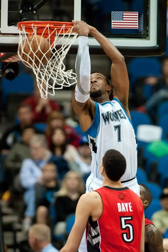 Oct 12, 2013; Minneapolis, MN, USA; Minnesota Timberwolves power forward Derrick Williams (7) dunks for a basket against Toronto Raptors power forward Austin Daye (5) in the fourth quarter at Target Center. Raptors won 104-97. Mandatory Credit: Greg Smith-USA TODAY Sports