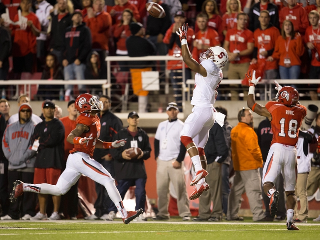 Oct 12, 2013; Salt Lake City, UT, USA; Stanford Cardinal wide receiver Kodi Whitfield (9) goes up for a catch in front of Utah Utes defensive back Eric Rowe (18) during the second half at Rice-Eccles Stadium. Utah defeated Stanford 27-21. Mandatory Credit: Russ Isabella-USA TODAY Sports