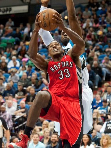 Oct 12, 2013; Minneapolis, MN, USA; Toronto Raptors small forward Chris Wright (33) drives to the basket against the Minnesota Timberwolves in the fourth quarter at Target Center. Raptors won 104-97. Mandatory Credit: Greg Smith-USA TODAY Sports