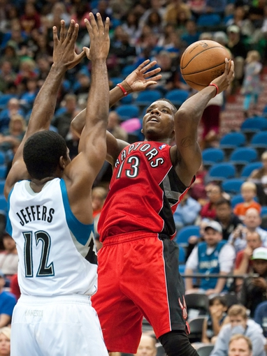 Oct 12, 2013; Minneapolis, MN, USA; Toronto Raptors point guard Dwight Buycks (13) shoots while defended by Minnesota Timberwolves shooting guard Othyus Jeffers (12) in the fourth quarter at Target Center. Raptors won 104-97. Mandatory Credit: Greg Smith-USA TODAY Sports