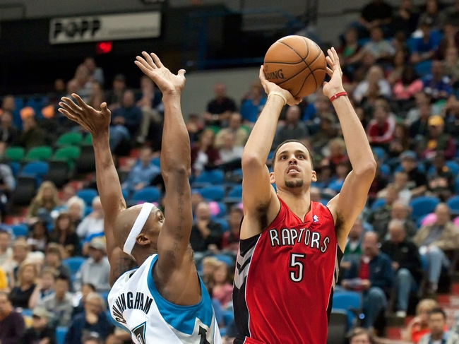 Oct 12, 2013; Minneapolis, MN, USA; Toronto Raptors power forward Austin Daye (5) shoots while defended by Minnesota Timberwolves power forward Dante Cunningham (33) in the fourth quarter at Target Center. Raptors won 104-97. Mandatory Credit: Greg Smith-USA TODAY Sports