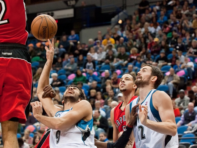 Oct 12, 2013; Minneapolis, MN, USA; Minnesota Timberwolves point guard Ricky Rubio (9) drives to the basket against the Toronto Raptors and is fouled in the second quarter at Target Center. Raptors won 104-97. Mandatory Credit: Greg Smith-USA TODAY Sports