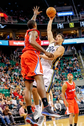 Oct 12, 2013; Salt Lake City, UT, USA; Utah Jazz center Enes Kanter (0) shoots over Los Angeles Clippers center DeAndre Jordan (6) during the third quarter at EnergySolutions Arena. The Los Angeles Clippers won 106-74.  Mandatory Credit: Chris Nicoll-USA TODAY Sports
