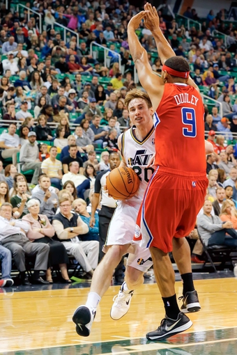 Oct 12, 2013; Salt Lake City, UT, USA; Utah Jazz small forward Gordon Hayward (20) runs into Los Angeles Clippers shooting guard Jared Dudley (9) during the third quarter at EnergySolutions Arena. The Los Angeles Clippers won 106-74.  Mandatory Credit: Chris Nicoll-USA TODAY Sports