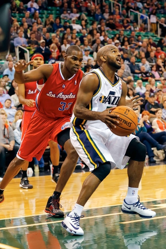 Oct 12, 2013; Salt Lake City, UT, USA; Utah Jazz point guard John Lucas III (5) looks to shoot the ball during the third quarter at EnergySolutions Arena. The Los Angeles Clippers won 106-74.  Mandatory Credit: Chris Nicoll-USA TODAY Sports