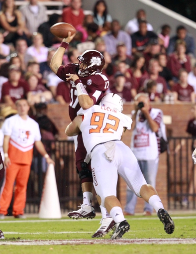 Oct 12, 2013; Starkville, MS, USA; Mississippi State Bulldogs quarterback Tyler Russell (17) is hit by Bowling Greene Falcons defensive end Zach Colvin (92) at Davis Wade Stadium. The Bulldogs defeated the Falcons 21-20. Mandatory Credit: Marvin Gentry-USA TODAY Sports