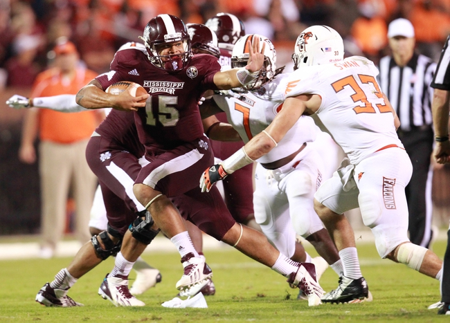 Oct 12, 2013; Starkville, MS, USA; Mississippi State Bulldogs quarterback Dak Prescott (15) carries the ball against the Bowling Green Falcons at Davis Wade Stadium. The Bulldogs defeated the Falcons 21-20. Mandatory Credit: Marvin Gentry-USA TODAY Sports
