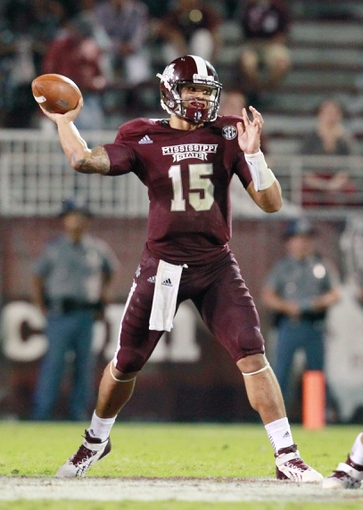 Oct 12, 2013; Starkville, MS, USA; Mississippi State Bulldogs Dak Prescott (15) drops back to pass against the Bowling Green Falcons at Davis Wade Stadium. The Bulldogs defeated the Falcons 21-20. Mandatory Credit: Marvin Gentry-USA TODAY Sports