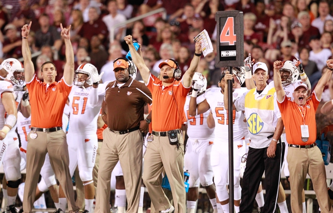 Oct 12, 2013; Starkville, MS, USA; Bowling Green Falcons head coach Dave Clawson (center) reacts after the Mississippi State Bulldogs missed a field goal during the game at Davis Wade Stadium. The Bulldogs defeated the Falcons 21-20. Mandatory Credit: Marvin Gentry-USA TODAY Sports