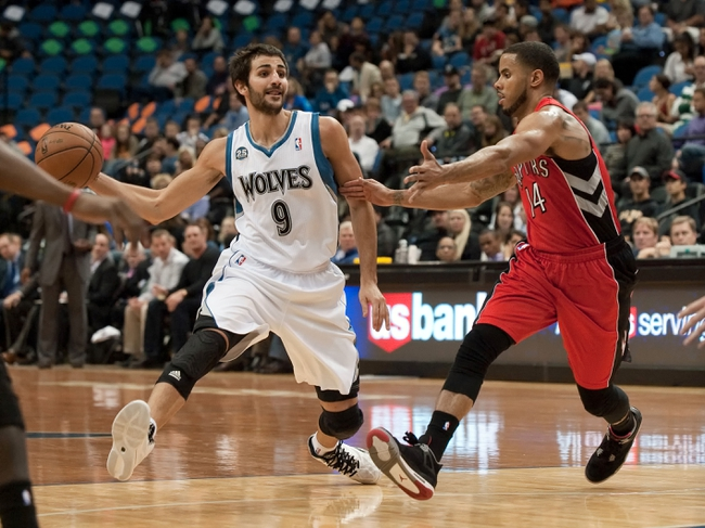 Oct 12, 2013; Minneapolis, MN, USA; Minnesota Timberwolves point guard Ricky Rubio (9) passes while defended by Toronto Raptors point guard D.J. Augustin (14) in the second quarter at Target Center. Raptors won 104-97. Mandatory Credit: Greg Smith-USA TODAY Sports