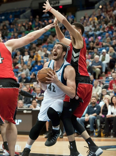 Oct 12, 2013; Minneapolis, MN, USA; Minnesota Timberwolves power forward Kevin Love (42) drives to the basket against the Toronto Raptors in the second quarter at Target Center. Raptors won 104-97. Mandatory Credit: Greg Smith-USA TODAY Sports