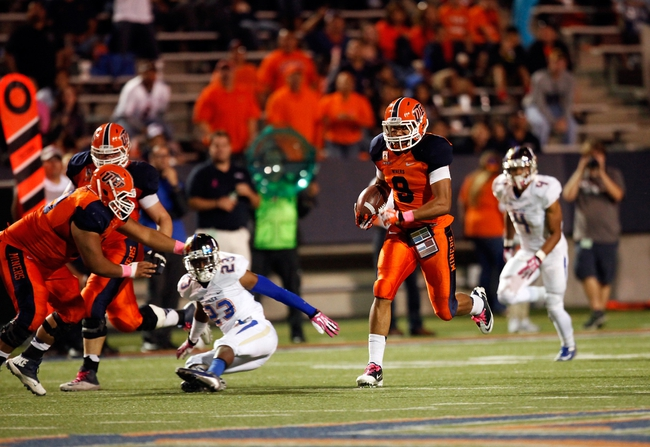 Oct 12, 2013; El Paso, TX, USA; UTEP Miners wide receiver Jordan Leslie (9) runs for a touchdown after a catch against the Tulsa Hurricane defense at Sun Bowl Stadium. Tulsa defeated UTEP 34-20. Mandatory Credit: Ivan Pierre Aguirre-USA TODAY Sports