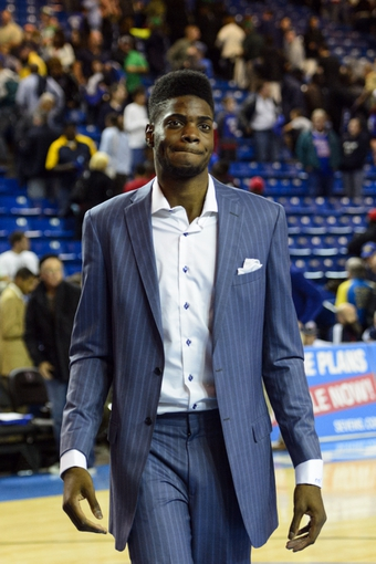 Oct 11, 2013; Newark, DE, USA; Philadelphia 76ers center Nerlens Noel (4) walks off the court after the game against the Boston Celtics at Bob Carpenter Sports Convocation Center. The Sixers defeated the Celtics 97-85. Mandatory Credit: Howard Smith-USA TODAY Sports
