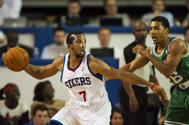 Oct 11, 2013; Newark, DE, USA; Philadelphia 76ers guard Darius Morris (7) is defended by Boston Celtics guard Phil Pressey (26) during the fourth quarter at Bob Carpenter Sports Convocation Center. The Sixers defeated the Celtics 97-85. Mandatory Credit: Howard Smith-USA TODAY Sports