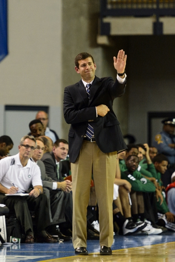 Oct 11, 2013; Newark, DE, USA; Boston Celtics head coach Brad Stevens during the fourth quarter against the Philadelphia 76ers at Bob Carpenter Sports Convocation Center. The Sixers defeated the Celtics 97-85. Mandatory Credit: Howard Smith-USA TODAY Sports