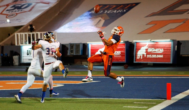 Oct 12, 2013; El Paso, TX, USA; UTEP Miners wide receiver Jordan Leslie (9) tries to catch a touchdown pass against the Tulsa Hurricane defense at Sun Bowl Stadium. Tulsa defeated UTEP 34-20. Mandatory Credit: Ivan Pierre Aguirre-USA TODAY Sports