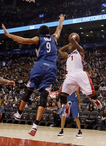 Oct 9, 2013; Toronto, Ontario, CAN; (Editors note: Caption correction) Toronto Raptors guard Kyle Lowry (7) goes to pass as Minnesota Timberwolves guard Ricky Rubio (9) defends at the Air Canada Centre. Minnesota defeated Toronto 101-89. Mandatory Credit: John E. Sokolowski-USA TODAY Sports
