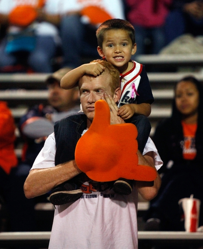 Oct 12, 2013; El Paso, TX, USA;  A father and son watch the UTEP Miners face the Tulsa Hurricane at Sun Bowl Stadium. Mandatory Credit: Ivan Pierre Aguirre-USA TODAY Sports