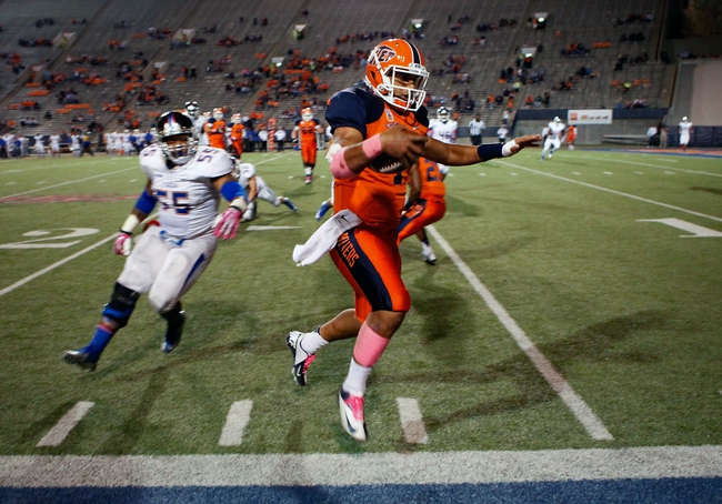 Oct 12, 2013; El Paso, TX, USA; UTEP Miners quarterback Jameill Showers (1) runs out of bounce to stop the clock as the Tulsa Hurricane defense gives chase at Sun Bowl Stadium. Tulsa defeated UTEP 34-20. Mandatory Credit: Ivan Pierre Aguirre-USA TODAY Sports