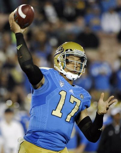 Oct 12, 2013; Pasadena, CA, USA; UCLA Bruins quarterback Brett Hundley (17) throws a pass during the fourth quarter against the California Golden Bears during there Bruins 37-10 win at Rose Bowl.  Mandatory Credit: Robert Hanashiro-USA TODAY Sports