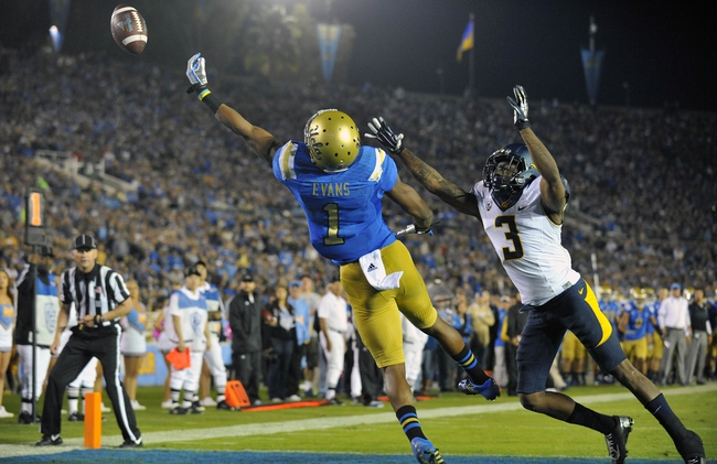 October 12, 2013; Pasadena, CA, USA; UCLA Bruins wide receiver Shaquelle Evans (1) misses catching a pass against the California Golden Bears during the second half at the Rose Bowl. Mandatory Credit: Gary A. Vasquez-USA TODAY Sports
