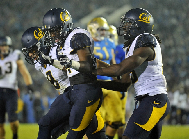 October 12, 2013; Pasadena, CA, USA; California Golden Bears cornerback Cameron Walker (14) celebrates a defensive play against the UCLA Bruins during the second half at the Rose Bowl. Mandatory Credit: Gary A. Vasquez-USA TODAY Sports