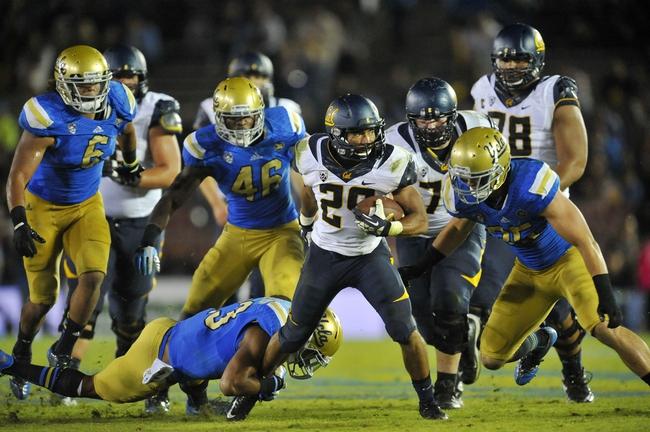 October 12, 2013; Pasadena, CA, USA; California Golden Bears running back Khalfani Muhammad (29) runs the ball against the UCLA Bruins during the second half at the Rose Bowl. Mandatory Credit: Gary A. Vasquez-USA TODAY Sports