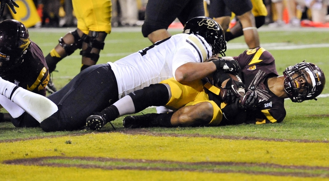 Oct 12, 2013; Tempe, AZ, USA; Arizona State Sun Devils running back R.J. Robinson (35) scores a touchdown during the third quarter against the Colorado Buffaloes at Sun Devil Stadium. The Sun Devils beat the Buffaloes 54-13. Mandatory Credit: Casey Sapio-USA TODAY Sports