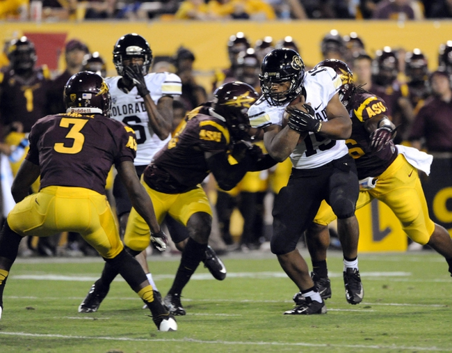 Oct 12, 2013; Tempe, AZ, USA; Colorado Buffaloes running back Michael Adkins II (19) runs the ball against the Arizona State Sun Devils during the third quarter at Sun Devil Stadium. The Sun Devils beat the Buffaloes 54-13. Mandatory Credit: Casey Sapio-USA TODAY Sports