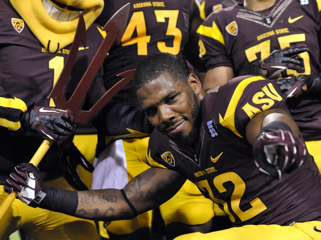 Oct 12, 2013; Tempe, AZ, USA; Arizona State Sun Devils running back Jarek Hilgers (32) celebrates after the game against the Colorado Buffaloes at Sun Devil Stadium. The Sun Devils beat the Buffaloes 54-13. Mandatory Credit: Casey Sapio-USA TODAY Sports