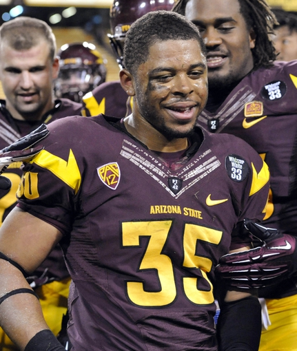 Oct 12, 2013; Tempe, AZ, USA; Arizona State Sun Devils running back R.J. Robinson (35) celebrates after the game against the Colorado Buffaloes at Sun Devil Stadium. The Sun Devils beat the Buffaloes 54-13. Mandatory Credit: Casey Sapio-USA TODAY Sports