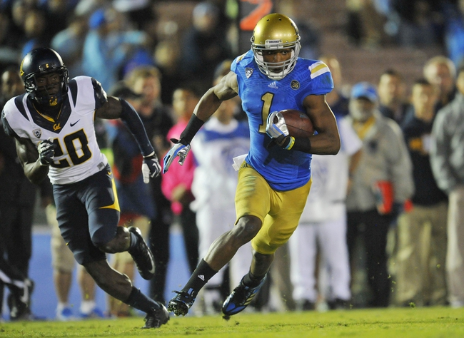 October 12, 2013; Pasadena, CA, USA; UCLA Bruins wide receiver Shaquelle Evans (1) runs the ball to score a touchdown against the California Golden Bears during the second half at the Rose Bowl. Mandatory Credit: Gary A. Vasquez-USA TODAY Sports