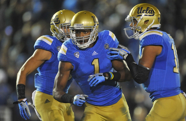 October 12, 2013; Pasadena, CA, USA; UCLA Bruins wide receiver Shaquelle Evans (1) celebrates after he runs the ball to score a touchdown against the California Golden Bears during the second half at the Rose Bowl. Mandatory Credit: Gary A. Vasquez-USA TODAY Sports