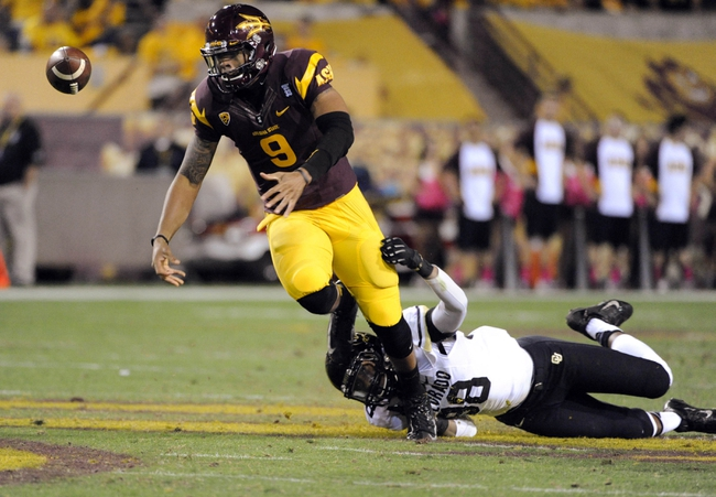 Oct 12, 2013; Tempe, AZ, USA; Arizona State Sun Devils quarterback Michael Eubank (9) fumbles the ball as he is tackled by Colorado Buffaloes defensive lineman Jimmie Gilbert (98) during the third quarter at Sun Devil Stadium. The Sun Devils beat the Buffaloes 54-13. Mandatory Credit: Casey Sapio-USA TODAY Sports