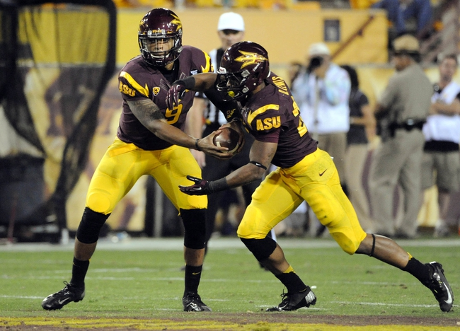 Oct 12, 2013; Tempe, AZ, USA; Arizona State Sun Devils quarterback Michael Eubank (9) hands off to running back Deantre Lewis (25) during the third quarter against the Colorado Buffaloes at Sun Devil Stadium. The Sun Devils beat the Buffaloes 54-13. Mandatory Credit: Casey Sapio-USA TODAY Sports