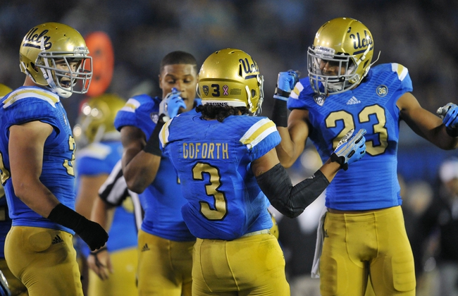 October 12, 2013; Pasadena, CA, USA; UCLA Bruins safety Randall Goforth (3) is congratulated by cornerback Anthony Jefferson (23) after intercepting a pass against the California Golden Bears during the second half at the Rose Bowl. Mandatory Credit: Gary A. Vasquez-USA TODAY Sports