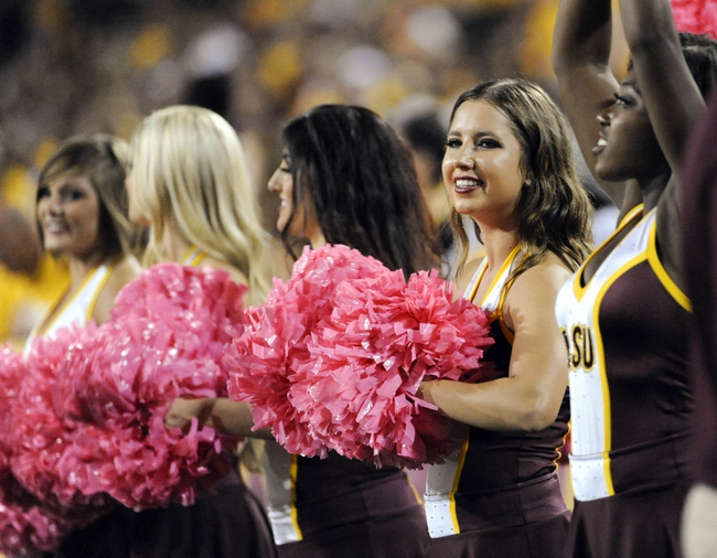Oct 12, 2013; Tempe, AZ, USA; Arizona State Sun Devils cheerleaders on the sidelines during the third quarter against the Colorado Buffaloes at Sun Devil Stadium. The Sun Devils beat the Buffaloes 54-13. Mandatory Credit: Casey Sapio-USA TODAY Sports
