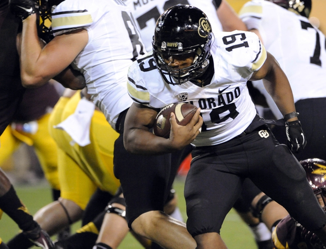 Oct 12, 2013; Tempe, AZ, USA; Colorado Buffaloes running back Michael Adkins II (19) runs the ball against the Arizona State Sun Devils during the fourth quarter at Sun Devil Stadium. The Sun Devils beat the Buffaloes 54-13. Mandatory Credit: Casey Sapio-USA TODAY Sports