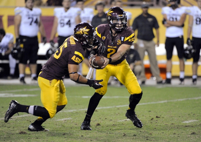 Oct 12, 2013; Tempe, AZ, USA; Arizona State Sun Devils quarterback Mike Bercovici (2) hands off to running back R.J. Robinson (35) during the fourth quarter against the Colorado Buffaloes at Sun Devil Stadium. The Sun Devils beat the Buffaloes 54-13. Mandatory Credit: Casey Sapio-USA TODAY Sports