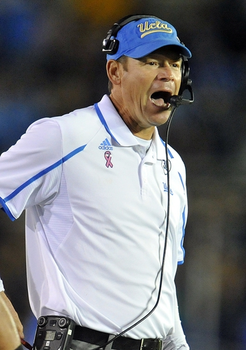 October 12, 2013; Pasadena, CA, USA; UCLA Bruins head coach Jim Mora watches game action against the California Golden Bears during the second half at the Rose Bowl. Mandatory Credit: Gary A. Vasquez-USA TODAY Sports